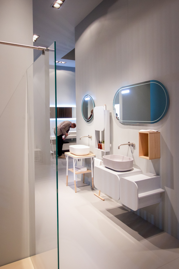 modern bathroom with rounded mirrors