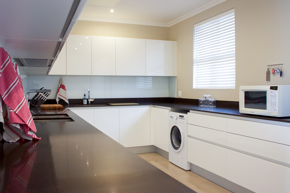 The scullery retains the colour scheme of the formal kitchen, housing many of the hardworking appliances too.