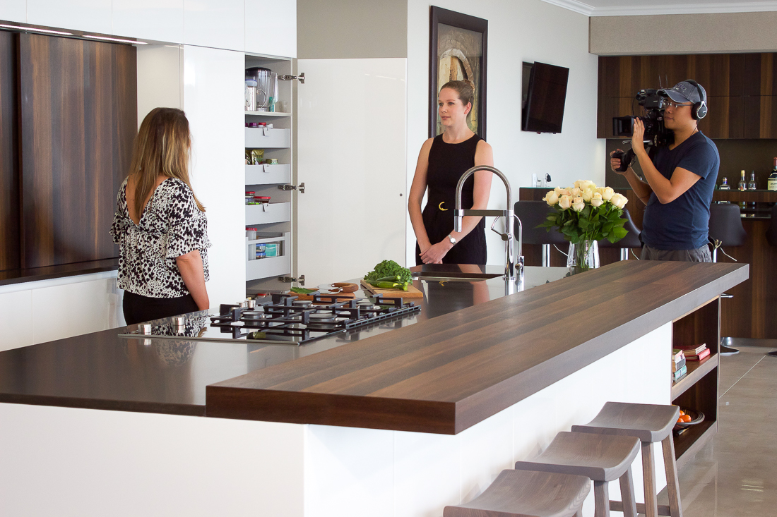 A behind-the-scenes shot of Lisa Aspeling interviewing designer, Mathilda Pienaar about her imported kitchens category finalist kitchen design.