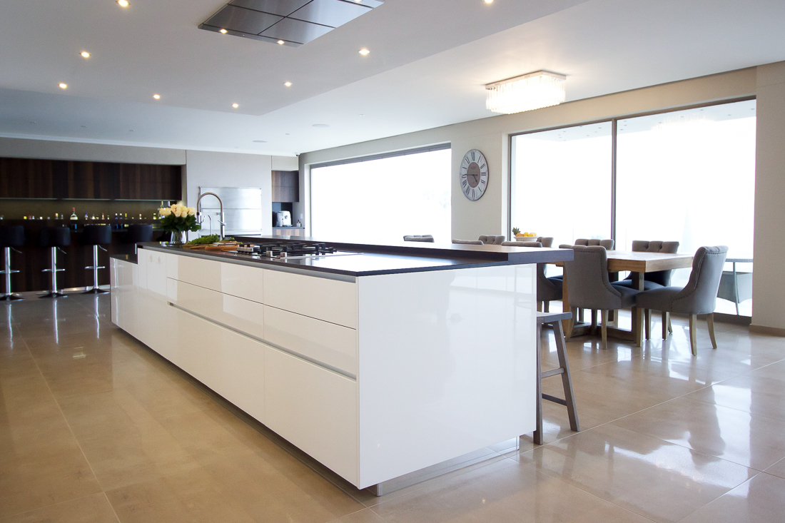 The kitchen island appears to be floating - an effect created by raising the island on a plinth.