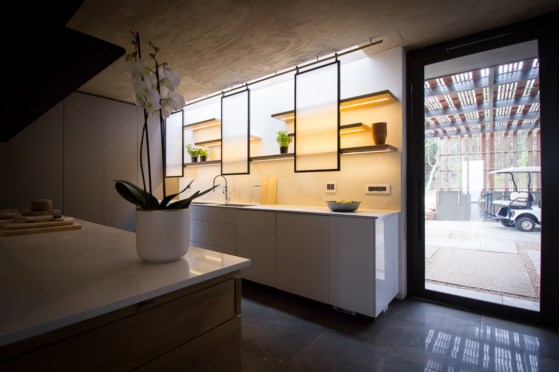 An inside-out view of the scullery with a skylight allowing natural light to flood into the area.
