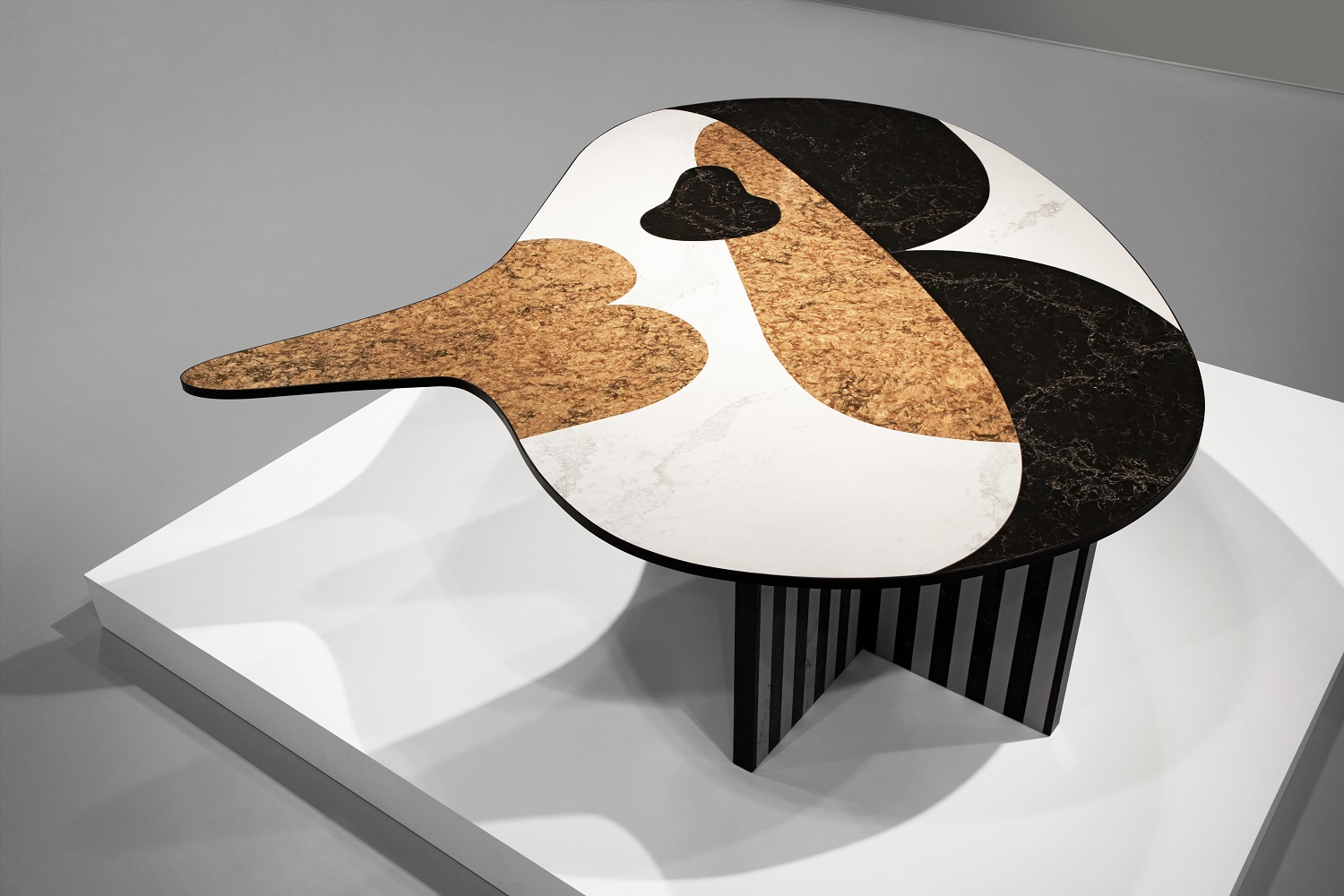 A table designed by Jaime Hayon, incorporating multiple Caesarstone surfaces.