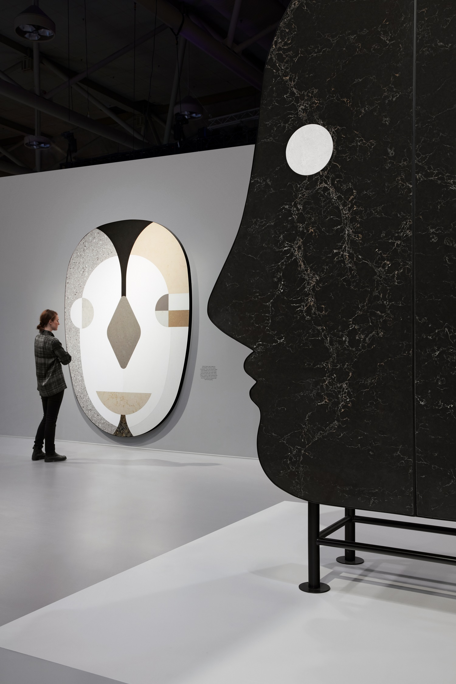 An unusual cabinet design inspired by masks, featuring a variety of Caesarstone quartz surfaces.